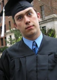 Jeff in a cap and gown for graduation.